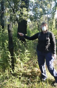 Gay pointing out what's left of the old Border Post from the black summer bushfires