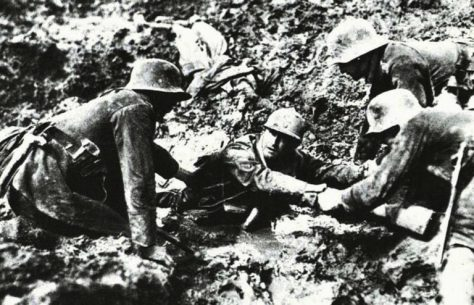 German-troops-trying-to-rescue-a-French-soldier-from-sinking-in-a-mud-hole-1918-768x494