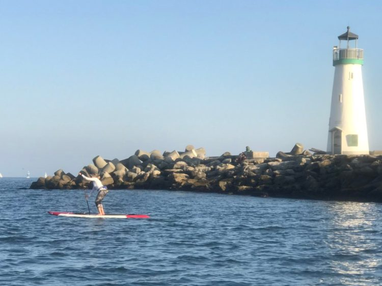 Leisl Ludington paddling in the harbor
