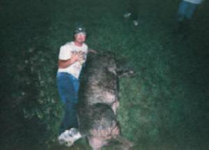 Jim beside the BIG hog