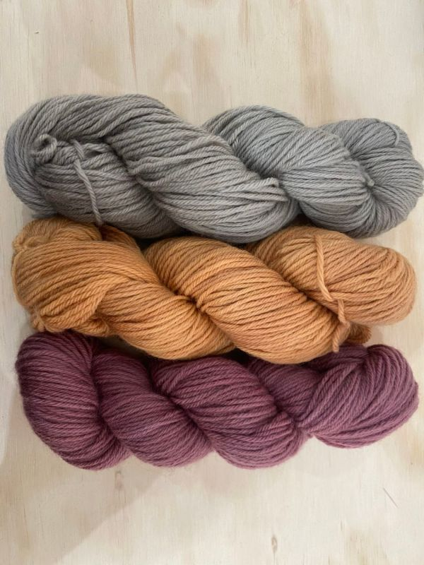 3 skeins of corriedale worsted-spun yarn, naturally dyed with eucalyptus and elderberry
