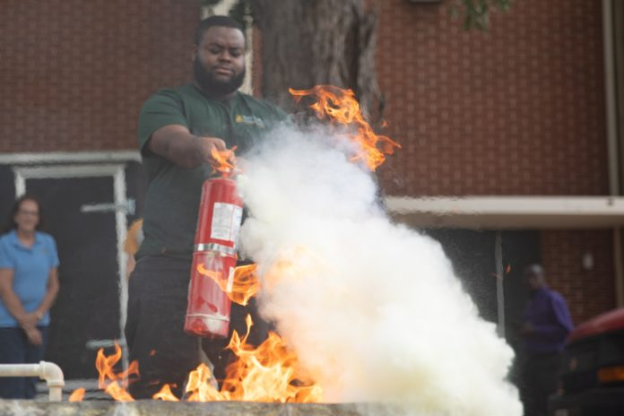 Students Learn Fire Safety How To Use Fire Extinguisher
