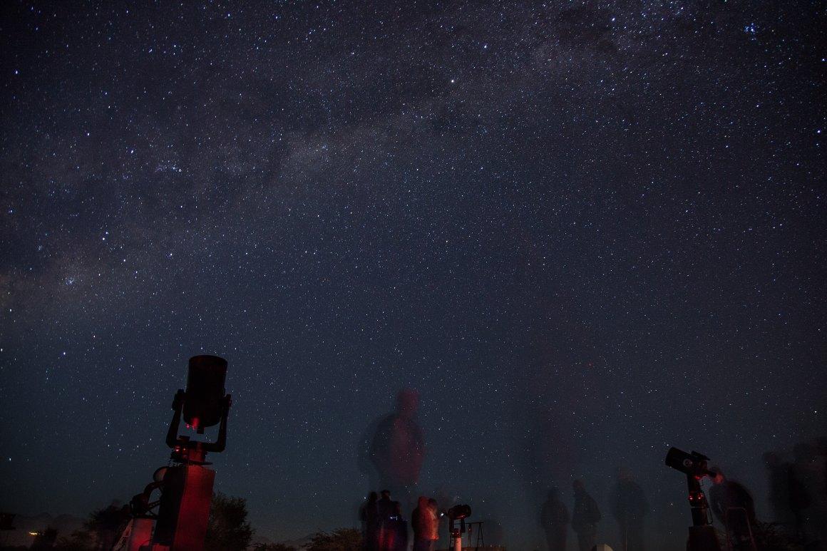 telescopes pointed towards a stary night sky
