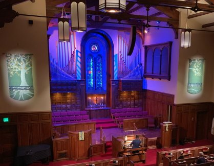 About us, welcome to Bay Shore Church organ image with blue lighting