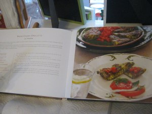 photo of cookbook open to Swiss Chard Omelette recipe and photo