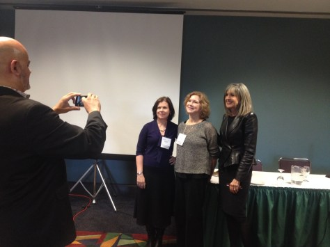 authors having their picture taken after program