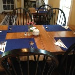 table set with blue placemats and white napkins