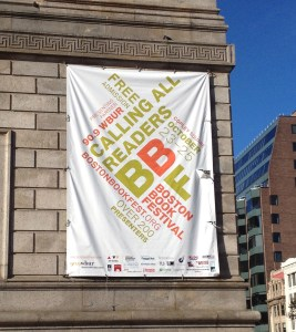 The banner hanging on the corner of the Boston Public Library Central branch is the first sign that you have arrived, after coming up from the Copley T station.