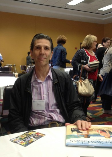 photo of author at table