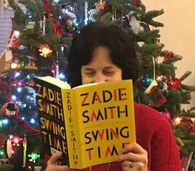 me reading Swing Time in front of Christmas tree