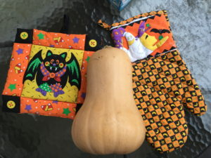 butternut squash with Halloweenn potholders