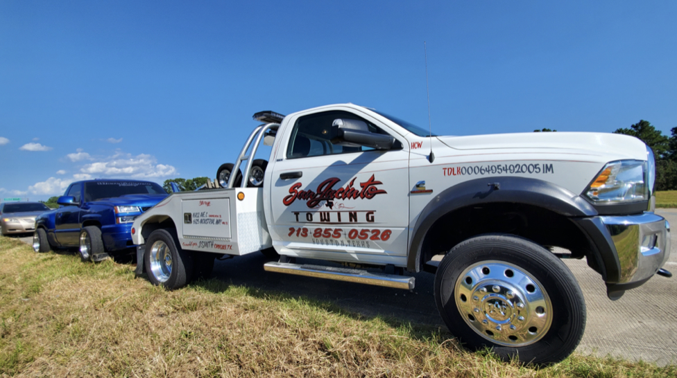 Jeff Smith Baytown Towing- Towing service for light duty vehicles. Company truck towing specialty low rider truck.