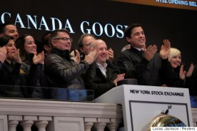 CEO of Canada Goose Dani Reiss applauds the company's IPO above the floor of the NYSE shortly after the opening bell in New York