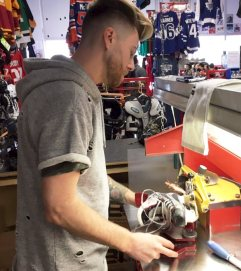 Tyler sharpens skates in Pro Shop