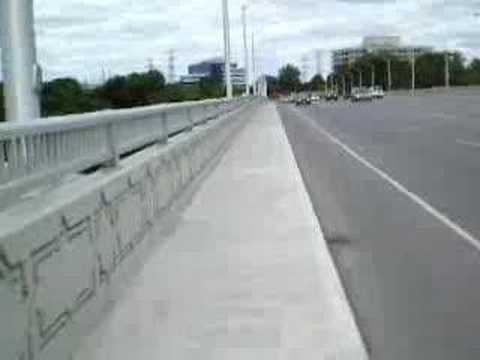 Cyclist hits (hit by?) cop car door at call on Leaside Bridge