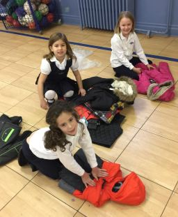 Children pack Outreach donations