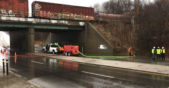 Pumping water out from under CP line on Bayview Extension
