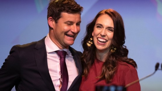 New Zealand Prime Minister Jacinda Ardern is congratulated by her partner Clarke Gayford following her victory speech to Labour Party members in Auckland