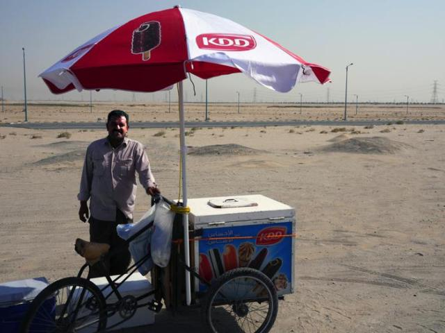 "Tim on Mohammad Ice Cream:  ""The Syrian ice cream guy.  He was riding 20 kilo a day back and forth and sitting out there in the hot sun in Khiran.  They pay rent on the cart, so who knows how much they are making.  Sometimes I ask sometimes I don't."""