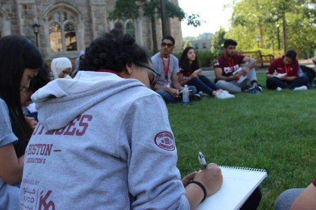 Reflecting on the grass at Boston College.