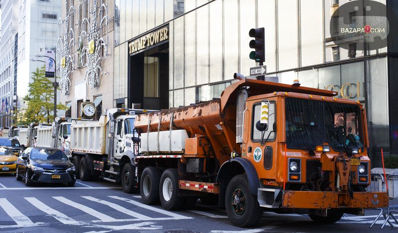 Dump trucks line Fifth Avenue in front of Trump Tower, where Republican Presidential candidate Donald Trump lives, during Election Day for the 2016 US presidential election New York, New York, USA, 08 November 2016. Americans are voting on Election Day to choose the 45th President of the United States of America who will serve from 2017 through 2020. EPA/JUSTIN LANE