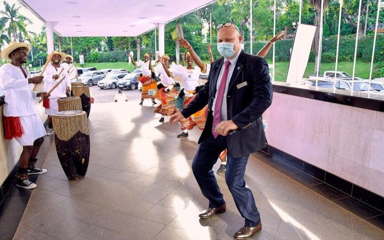 Sheraton Kampala General manger, Jean Phillipe Benttencourt participates in a traditional dance by crane performers.