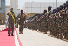 New interim Malian President, Colonel Assimi Goita (L), salutes members of the Malian Armed Forces after his swearing in ceremony in Bamako on June 7, 2021. PHOTO/AFP