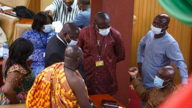 Members of Parliament of Ghana interact during a break from electing a new leader of parliament in Accra, Ghana, on January 7, 2021.