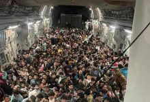 Afghans fleeing Kabul in a US Plane - Courtesy Photo