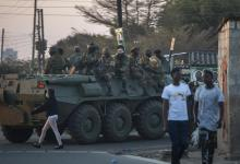 Zambian Defense Forces patrol on an armored personal carrier (APC) in Lusaka on August 12, 2021