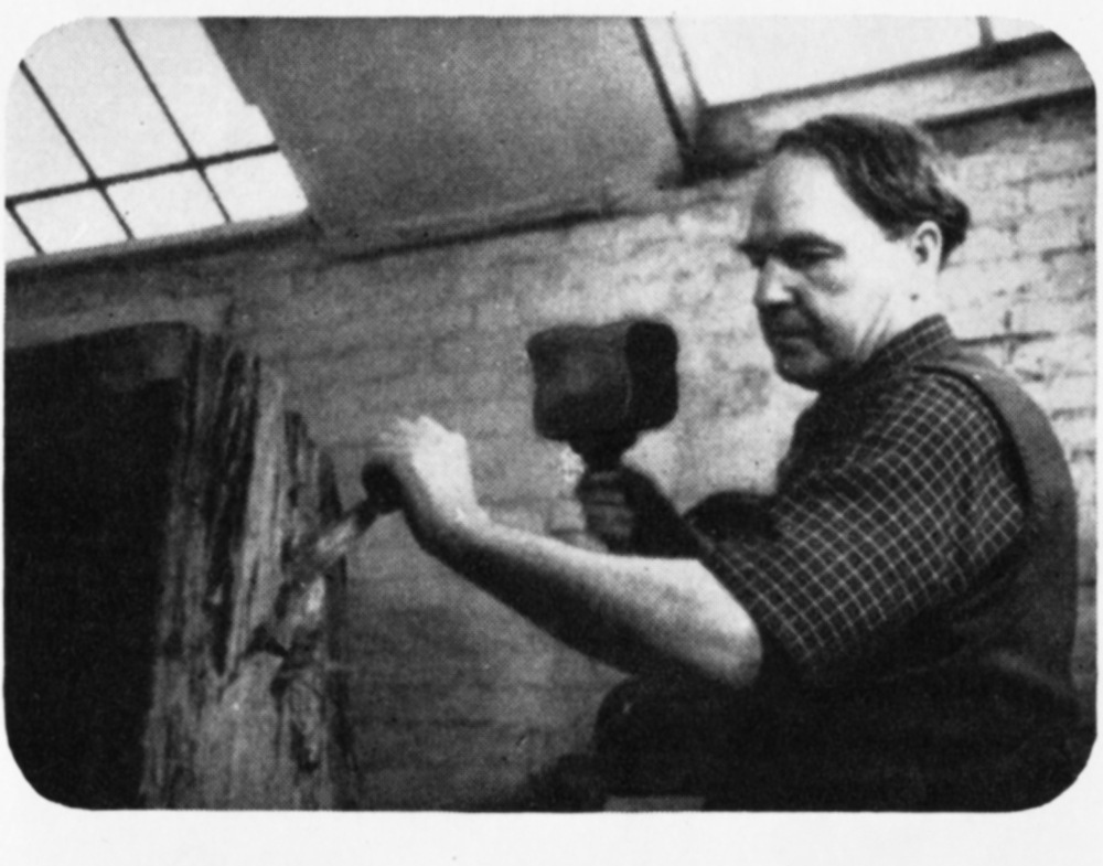 The sculptor at work with a hammer and chisel