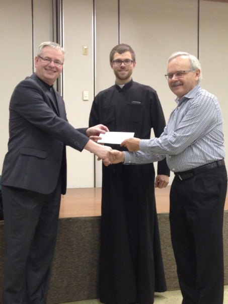 Andrij Lazurko presenting the 2015 Eparchial Appeal Rebate cheque to Father Vladimir Simunovic and Myron Sereda of St. Basil's Parish in Regina,