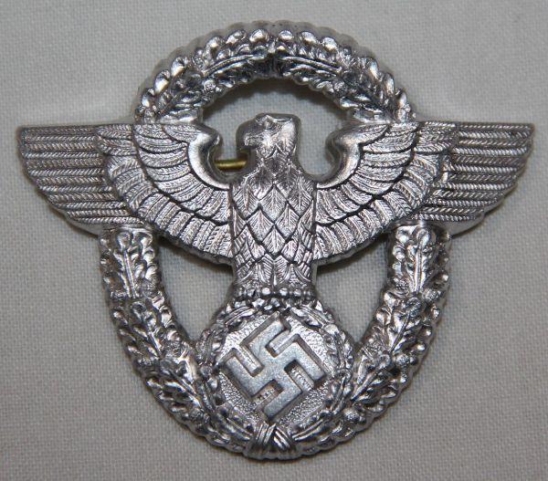 P005. UNISSUED WWII GERMAN POLICE VISOR CAP EAGLE