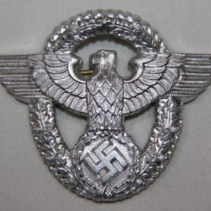 P005. UNISSUED WWII GERMAN POLICE VISOR CAP EAGLE