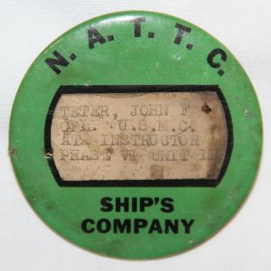 H024. WWII N.A.T.T.C. SHIP'S COMPANY ID BADGE TO A U.S. MARINE