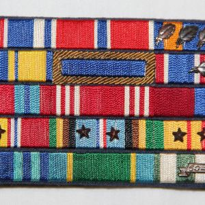 T010. VIETNAM USAF 15 PLACE MOUNTED RIBBON BAR, THEATER MADE