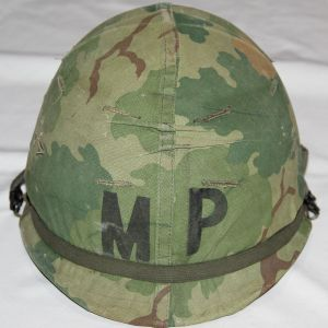 T016. LATE VIETNAM MILITARY POLICE M1 HELMET WITH COMPLETE LINER