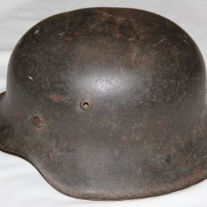 L012. WWII GERMAN ARMY M42 COMBAT HELMET WITH LINER