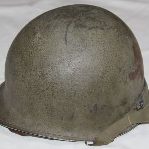 C026. WWII FRONT SEAM SWIVEL LOOP M1 HELMET WITH UNIT MARKED WESTINGHOUSE LINER