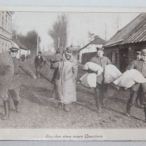 B120. WWI GERMAN POSTCARD SOLDIERS MOVING TO NEW QUARTERS