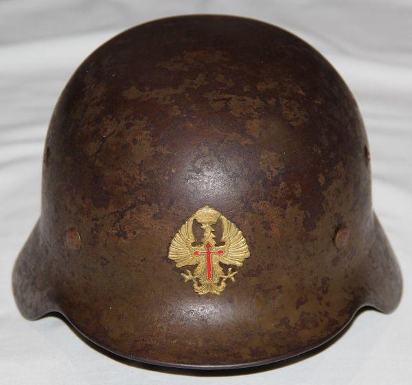 L037. WWII GERMAN M35 COMBAT HELMET REISSUED TO THE SPANISH