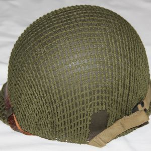 C044. NAMED WWII FIXED LOOP M1 HELMET WITH INLAND LINER AND NET