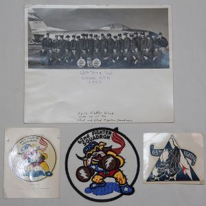 S060. COLD WAR USAF NAMED 62ND FIGHTER SQUADRON PATCH, DECAL AND PHOTO GROUP