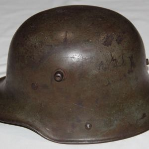 B153. WWI GERMAN M16 COMBAT HELMET WITH LINER