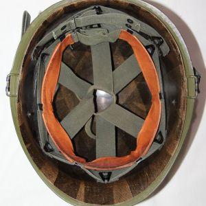 T179. VIETNAM M1 HELMET WITH EARLY LINER