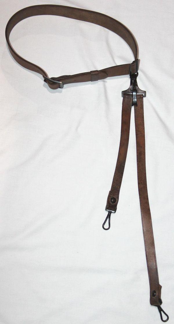 A040. NICE M1903 OFFICERS LEATHER GARRISON BELT WITH SWORD HANGER
