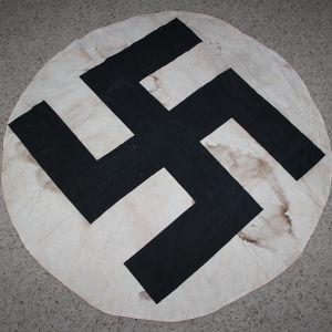 M084. LARGE REMOVED SWASTIKA FLAG ROUNDEL
