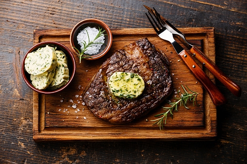 Grilled Rubbed Ribeye with Garlic Steakhouse Butter