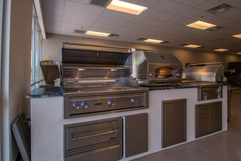 Custom Outdoor Kitchen with Lynx Barbecue Grill, Pizza Oven, Power Burner, Warming Drawer and Access Door & Drawers