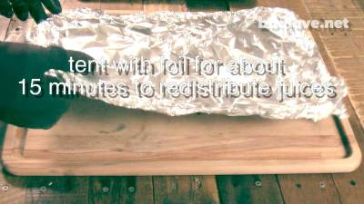 Put a piece of aluminum foil over the ribs as a tent for about 15 minutes. This will allow the juices to evenly distribute through out the meat. On a wood cutting board on a wood table.